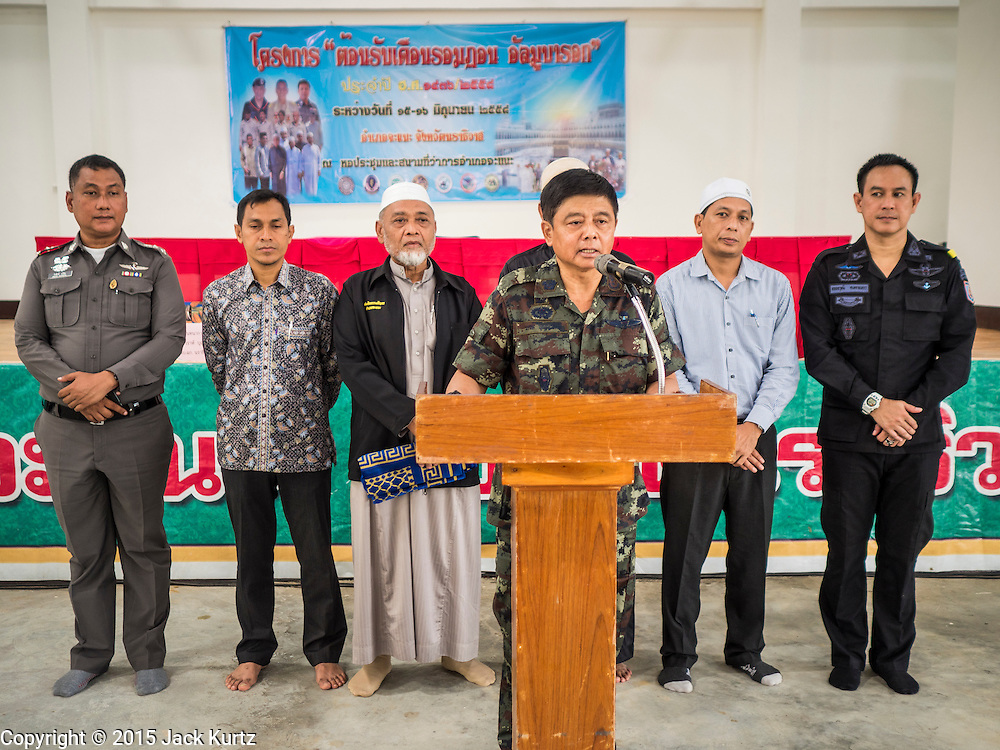 16 JUNE 2015 - CHANAE, NARATHIWAT, THAILAND:   Thai Army Major General VARA BOOMYASIT, commander of the Narathiwat Task Force, speaks to Muslims from Narathiwat during a prayer service Tuesday. About 600 people from Muslim communities in Chanae district of Narathiwat province came to the district offices Tuesday morning to participate in a prayer for peace during Ramadan. About 6,000 people have been killed in sectarian violence in Thailand's three southern provinces of Narathiwat, Pattani and Yala since a Muslim insurgency started in 2004. Attacks usually spike during religious holidays. Insurgents are fighting for more autonomy from the central government in Bangkok.      PHOTO BY JACK KURTZ