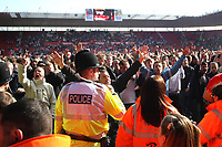 Police try and restore order after Southampton fans invade the pitch at the final whistle<br /> Southampton vs Burnley at St Mary's Stadium Southampton. Coca Cola Championship. 25/04/2009<br /> Credit Colorsport / Shaun Boggust