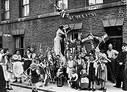 File photo dated 08/05/45 showing British men, women and children in the street celebrating VE (Victory in Europe) Day in London, marking the end of the Second World War in Europe, 75 years ago.