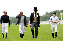 Horse trainer Aiden O'Brien with jockies including Ryan Moore (centre left) during day one of Royal Ascot at Ascot Racecourse.