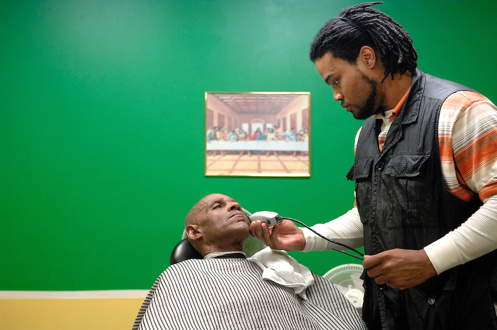 """Before Lloyd Hayes can unlock the front door of his barbershop, he has a customer waiting. The one-chair shop called All-Star Cuts at 601 Business Loop 70 has only been open for a year, but Lloyd feels blessed by the business.<br /> <br /> Throughout the morning, regulars stream through the glass doors and take a seat on one of the overstuffed chairs to wait their turn. Smooth jazz provides a quiet background for the wide-ranging conversations, which Lloyd says are the backbone of his business.<br /> <br /> """"The haircut is the icebreaker, that's the given,"""" he explains. """"The relationship-building is the real goal.""""<br /> <br /> To do that, Lloyd has worked hard to cultivate a positive environment. """"I want to bring back the professional atmosphere, not the hustle and bustle and loud loitering.""""<br /> <br /> Positive affirmations and religious iconography adorn the walls, painted green, white and gold. They are the colors of his high school back in Kansas City, but Lloyd explains they also stand for prosperity, peace and royalty. """"People say I'm too deep with this stuff, but everything matters,"""" he says.<br /> <br /> He is just as attentive with clippers and a straight razor.<br /> <br /> """"He gives me the mirror at the end,"""" loyal customer Terrence Williams says, """"but I don't even need it. I already know it's perfect.""""<br /> <br /> """"I treat this person in my chair as if it were me,"""" Lloyd says. """"I'm reviving their image of themselves, their self-worth and self-esteem.""""<br /> <br /> Hayes has a small, regular clientele that he hopes will grow with time. """"When you see them coming back, I'm inspired to keep them coming back,"""" Lloyd says.<br /> <br /> """"One day at a time, one head at a time."""""""