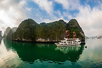 """Aclass Cruises """"Stellar"""" cruising in Halong Bay, North Vietnam. The bay features 3,000  limestone and dolomite karsts and islets in various shapes and sizes sprinkled over 1,500 square kilometers. It offers a wonderland of karst topography. It is a UNESCO World Heritage Site."""
