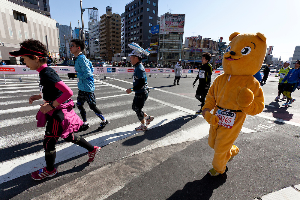 A runner dressed as a teddy bear in the Tokyo Marathon. Japan. Sunday February 24th 2013