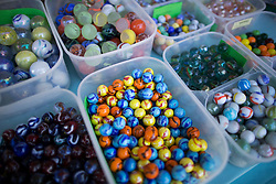 © Licensed to London News Pictures. 25/03/2016. Crawley, UK. Marbles are displayed for sale at the World Marbles Championships at the Greyhound pub in Tinsley Green near Crawley. The competition has taken place every year since 1932 with teams from the USA, Algeria, Australia and Europe taking part. Photo credit: Peter Macdiarmid/LNP