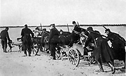 Belgian machine gunners transporting their weapons on carts pulled by dogs, c1914.