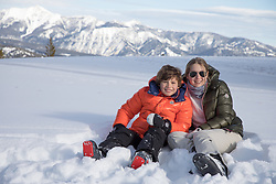 girl and boy in the snow at Big Sky, Montana