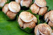 Coconut pancakes for sale at Luang Prabang morning market, Laos