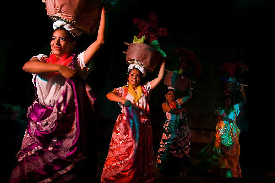 A dance troupe performs Chinas Oaxaquenas, from Oaxaca City, at an evening Guelaguetza performance in the courtyard of the Church of Carmen Alto in Oaxaca City, Oaxaca, Mexico on July 16, 2008. The Guelaguetza is an annual folk dance festival in Oaxaca - dancers from different regions of the state gather in celebration in Oaxaca City and towns in the Central Valley to perform their regional dances wearing traditional costumes and throw regional specialties as gifts into the crowds.