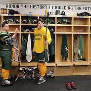 Hamden High School ice hockey players Eric Perez, (left), and Sam Carignan prepare for a training session at Hamden High School,  Hamden, Connecticut, USA. 20th February 2014. Photo Tim Clayton