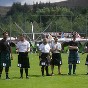 Highland Games, 3rd of August 2019, Newtonmore, Scotland, United Kingdom. Competitors in the strong man competition look on as one of their competitors throws the weight.  The Highland Games is a traditional annual event where competitors compete as strong men, runners, dancers, pipers and at tug-of-war. The games go back centuries and are happening through-out the summer across Scotland. The games are both an important event locally and a global tourist attraction.