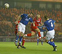 Photo. Andrew Unwin.<br /> Middlesbrough v Everton, Carling Cup Fourth Round, Riverside Stadium, Middlesbrough 03/12/2003.<br /> Middlesbrough's Massimo Maccarone (c) beats Everton's David Unsworth (l) in the air.