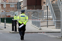 © Licensed to London News Pictures. 12/04/2017. LONDON, UK.  Police officers at the police cordon on Wager Street in Mile End in east London this morning. Police were called yesterday, 11th April at 16:46 to Wager Street in Tower Hamlets where a man was suffering from stabbing injuries. The 20 year old male victim was taken to hospital where he died shortly after.  This is the third young man stabbed to death in London in the last 24 hours. Photo credit: Vickie Flores/LNP