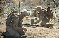 Marines position C-4 explosives to take out a line of razor-wire during live-fire exercises for the 2nd Battalion, 5th Marine Regiment at Camp Pendleton.
