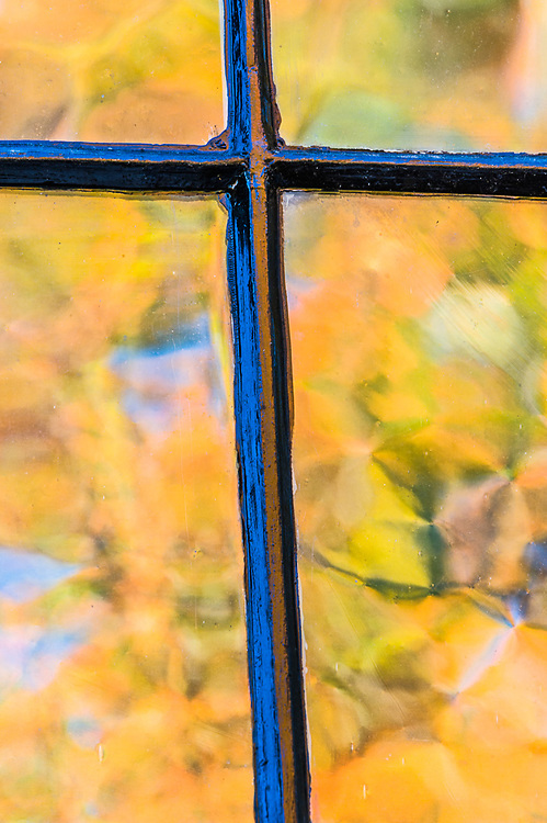 Autumn reflection on the Melville Academy windows, Historic Site, built in 1833, October, Jaffrey, New Hampshire, USA