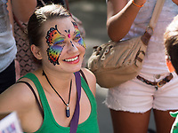 Woman with a painted face near the Heckscher playgound in Central Park