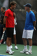 l to r: Roger Federer and John McEnroe at the Nike Youth Tennis  Challenge held at The Nike -Built regulation Tennis Court  on West 23rd Street & Broadway in New York  City . ..Hundreds of tennis fans and youth form New York  Parks and Rec. Athlethes for Charity, and Mentoring USA are treating to tips and guidance from Tennis Pros Roger Federer, Rafael Nadal and Serena Williams...