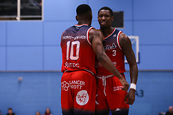 Raphell Thomas-Edwards of Bristol Flyers and Fred Thomas of Bristol Flyers celebrate a point - Photo mandatory by-line: Arron Gent/JMP - 02/11/2019 - BASKETBALL - Surrey Sports Park - Guildford, England - Surrey Scorchers v Bristol Flyers - British Basketball League Cup