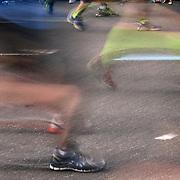 A blur of motion as runners feet make their way along First Avenue in Manhattan, New York, during the ING New York Marathon. New York, USA. 3rd November 2013. Photo Tim Clayton