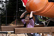 A young woman posing with the Cypress Pine phallus on the day of the Tagata Fertility Festival.