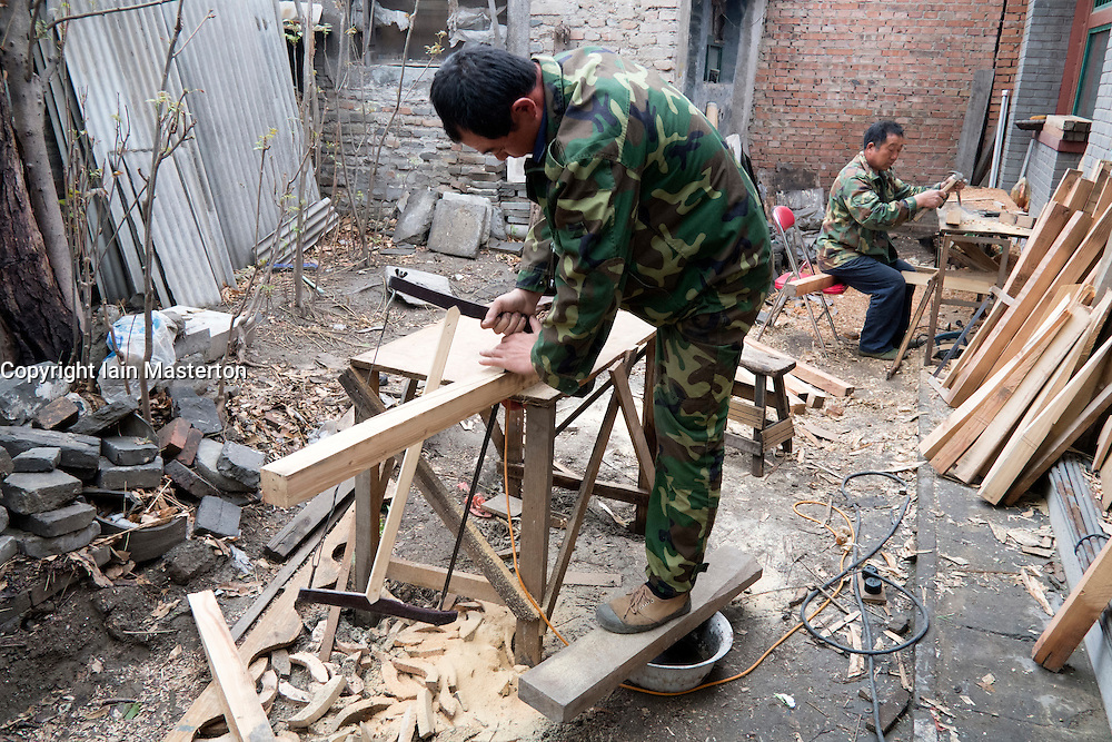 craftsmen working on renovation of  traditional old courtyard house in Beijing China