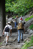 Bear Mountain, New York - Hikers walk up a newly rebuilt section of the Appalachian Trail during National Trails Day at Bear Mountain on June 5, 2010. A ceremony and hike celebrated the reconstruction of this original section of the Appalachian Trail. More than 800 volunteers, along with professionals, built 800 hand-hewn rock steps and a broad, gently sloping trail bed atop nearly a mile of rock wall.