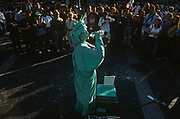 A week after the 9-11 terrorist attacks on the Twin Towers and the Pentagon, a Liberty busker drinks in front of a crowd in Union Square, on 21st September 2001, New York, USA.