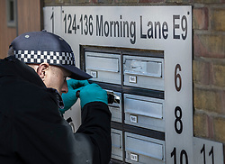 © Licensed to London News Pictures. 05/04/2018. London, UK. Police look in letter boxoes as they carry out a detailed search in Hackney after a 18 year old man, named locally as Israel Ogunsola, was stabbed. Police were approached by a man suffering from stab injuries at 8pm last night he was pronounced dead at 8. 24pm. Photo credit: Peter Macdiarmid/LNP