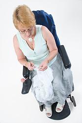 Female wheelchair user knitting,