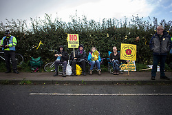 © Licensed to London News Pictures. 29/09/2017. Lancashire, UK.  A group of protesters take a break from the demonstration outside Cuadrillas Hydraulic Fracturing site on Preston New Road, Lancashire. Over 100 protesters from all over the UK joined the on going anti-fracking protest on Preston New Road in Lancashire ahead of the Conservative Party Conference in Manchester. Photo credit: Steven Speed/LNP