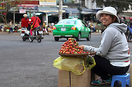 Smiling vendor sells srawberries along the roadside at an outdoor market in Dalat, Lam Dong Province, Vietnam, Southeast Asia