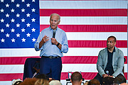 Former Vice President Joe Biden addresses a town hall meeting as State Senator Marlon Kimpson looks on, at the International Longshoreman's Association Hall July 7, 2019 in Charleston, South Carolina.