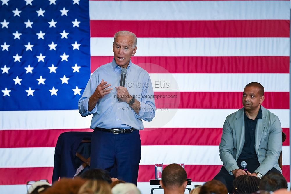 Former Vice President Joe Biden addresses a town hall meeting as State Senator Marlon Kimpson looks on, at the International Longshoreman's Association Hall July 7, 2019 in Charleston, South Carolina.