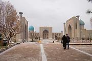 A couple walking towards Registan Square on 22nd February 2014 in Samarkand, Uzbekistan.