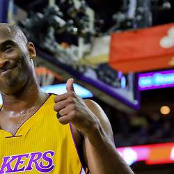 Apr 8, 2016; New Orleans, LA, USA; Los Angeles Lakers forward Kobe Bryant (24) gives a thumbs up following a video presentation of his career during the first quarter of a game against the New Orleans Pelicans at the Smoothie King Center. Mandatory Credit: Derick E. Hingle-USA TODAY Sports
