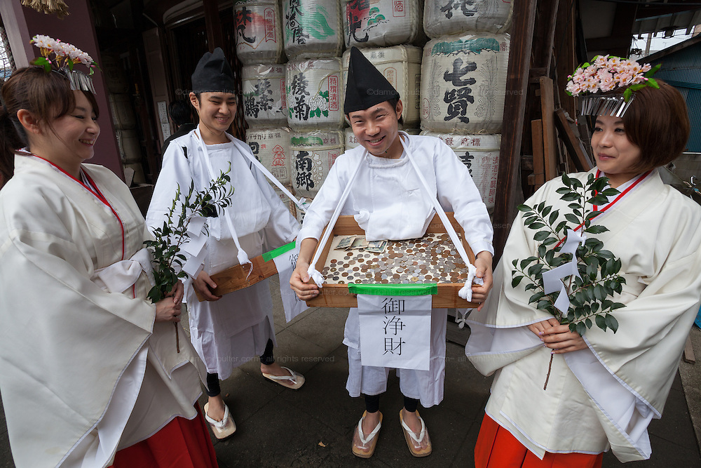 Shrine workers and shrine maidens collect donations and give blessings during the Kanamara Matsuri, (Festival of the Steel Phallus). Kawasaki Daishi, Kanagawa, Japan. Sunday April 3rd 2016. The famous Kawasaki Penis Festival started in 1977 as a small festival to celebrate an old legend about the defeat of a penis eating demon. Today the festival is a huge draw for Japanese and foreign tourists and raises money for HIV and AIDS research.