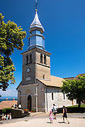Tourist visit Saint Pancrace d'Yvoire church in the old district of Yvoire by Lac Leman, Lake Geneva, France