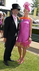 EDDIE JORDAN and MARIE JORDAN at the 2nd day of the 2013 Royal Ascot Horseracing festival at Ascot Racecourse, Ascot, Berkshire on 19th June 2013.