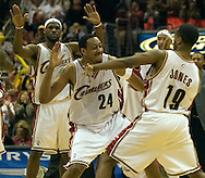 PHOTO BY DAVID RICHARD.Cleveland's Donyell Marshall, center, in congratulated by teammate Damon Jones after Marshall nailed a 3-pointer late in the fourth quarter last night against Boston. Celebrating in the background in LeBron James.