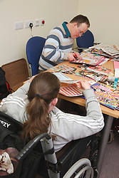 Clients doing craft activity at a resource for people with physical and sensory impairment.