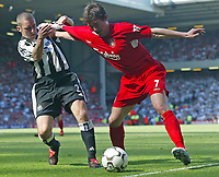 Photo. Andrew Unwin, Digitalsport<br /> NORWAY ONLY<br /> <br /> Liverpool v Newcastle United, FA Barclaycard Premier League, Anfield, Liverpool 15/05/2004.<br /> Liverpool's Harry Kewell (r) holds off Newcastle's Andrew Giffin (l).