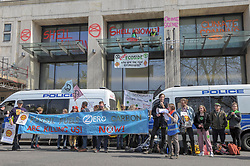 Members of Extinction Rebellion protested at Shell headquarters in London. The group sprayed graffiti on the building, and climbed onto a glass ledge where they poured a black substance down the wall. <br /> <br /> Richard Hancox   EEm 15042019
