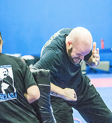 Students practising their elbow punches with the pads. Stef Noij, KMG Instructor from the Institute Krav Maga Netherlands, takes the IKMS G Level Programme seminar today at the Scottish Martial Arts Centre, Alloa.