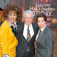Hoda Kotb as a young Kathie Lee Gifford, Regis Philbin, and Kathie Lee Gifford as a young Regis Philbin during the annual Halloween Episode of NBC's The Today Show in New York City.