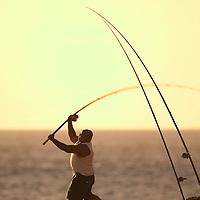 fisherman casting pole at Kaena Point