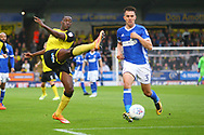 Burton Albion's Lucas Akins gets in a shot as Ipswich Town's Jonas Knudsen looks on during the EFL Sky Bet Championship match between Burton Albion and Ipswich Town at the Pirelli Stadium, Burton upon Trent, England on 28 October 2017. Photo by John Potts.