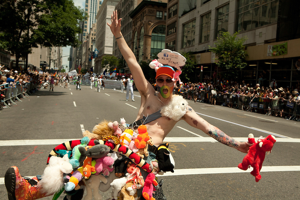 A participant in the 2011 Pride Parade down New York's Fifth Avenue, festooned wth stuffed animals.
