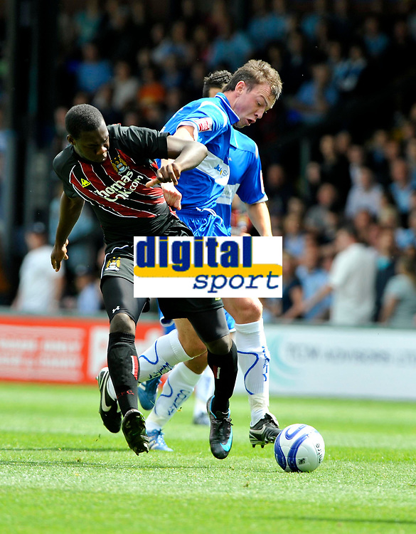 Stockport County's Michael Raynes (R) wins the ball from Manchester City's Felipe Caicedo.<br /> Photo: Paul Greenwood/Richard Lane Photography. Stockport County v Manchester City. Pre Season Friendy. 02/08/2008.