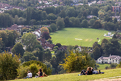 """© Licensed to London News Pictures. 11/09/2020. Surrey, UK. Picnickers enjoy glorious views and hazy sunshine before the """"Rule of 6"""" comes in to force on Monday from Box Hill in Surrey this afternoon as weather experts announce a 7 day mini-heatwave to hit England this week with highs in excess of 28c. Photo credit: Alex Lentati/LNP"""