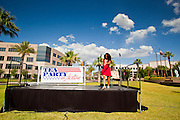 12 JUNE 2010 - PHOENIX, AZ: A tea party volunteer sets up the stage before a rally in support of SB 1070 in Phoenix, AZ, Saturday. About 500 people, many from California and Florida, came to Bolin Memorial Park in Phoenix Saturday. The pro SB 1070 rally was sponsored by Tea Party.   PHOTO BY JACK KURTZ