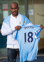 © Licensed to London News Pictures . 17/07/2015 . Manchester , UK . FABIAN DELPH poses with his new shirt outside the Etihad Stadium after signing for Manchester City Football Club , from Aston Villa . Photo credit : Joel Goodman/LNP
